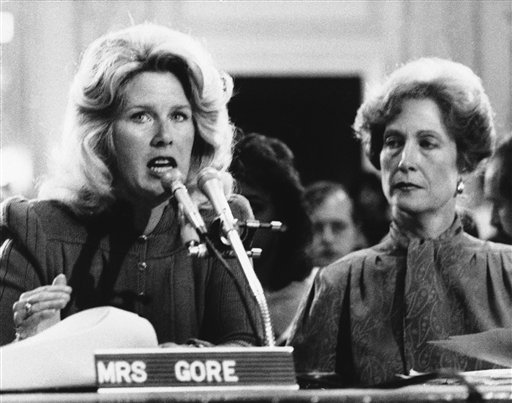Tipper Gore, left, wife of Sen. Albert Gore Jr., D-Tenn., testifies before the Senate Commerce Committee as Susan Baker, wife of Treasury Secretary James Baker III awaits her turn on Sept. 19, 1985 in Washington. The committee was holding hearings on record labeling. (AP Photo/Lana Harris)