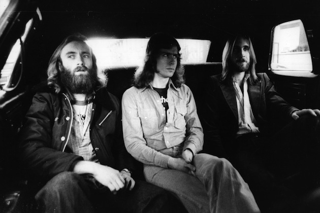 18th May 1977: British rock group Genesis, from left to right Phil Collins, Tony Banks and Mike Rutherford, in the back of a limousine on the way to the LA Forum where they are performing. (Photo by Graham Wood/Evening Standard/Getty Images)