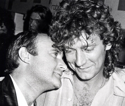 Musicians Phil Collins and Robert Plant attend Phil Collins Tour Party on September 12, 1983 at Be Bop Cafe in New York City. (Photo by Ron Galella/WireImage)