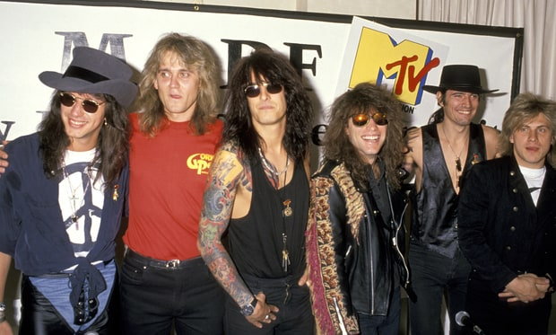 (From Left) Richie Sambora of Bon Jovi, Alexander Minkov of Gorky Park, Nikki Sixx of Mötley Crüe, Jon Bon Jovi, Tommy Lee of Mötley Crüe and Alexander Janenkov of Gorky Park announcing the Moscow Music and Peace Festival in May 1989. Ron Galella/WireImage